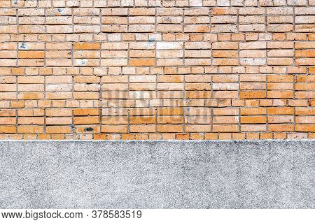 Brick Wall Background With Concrete Elements In The Form Of A Strip Of Foundation At The Bottom