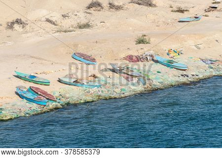 El Qantara, Egypt - November 14, 2019: Fishing Boats And Nets Lie On The Banks Of The Suez Canal In