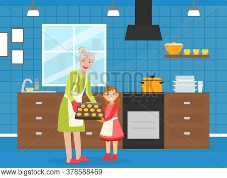 Grandma Baking Cookies With Her Granddaughter, Elderly Woman Spending Time At Home With Her Grandchi
