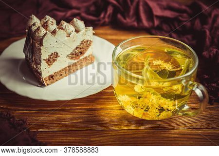 Cup Of Tea And Cake On A Wooden Table