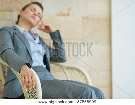 Closeup On Tired Business Woman Relaxing On Chair