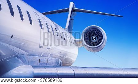 White Private Jet Against A Blue Sky
