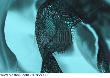 Black Silk Lace Lingerie, Aquamarine Fabric Background