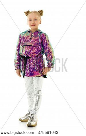 Cute Little Girl In Trousers. The Concept Of Style And Fashion. Isolated On A White Background.