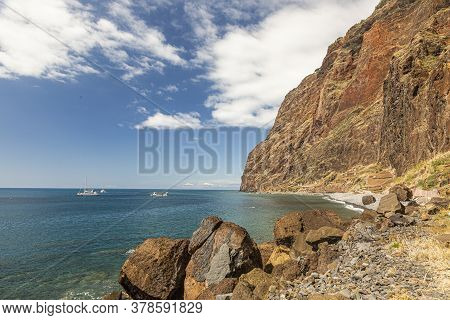 View Over The Stony Beach Of Fajas De Cabo Girao On The Portugese Island Of Madeira In Summer