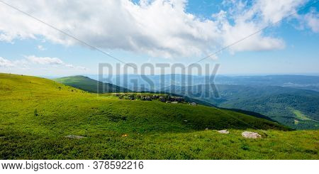 Meadow With Rocks On Grassy Alpine Meadow. Mountain Scenery On A Wonderful Sunny Day In Summer. Clou