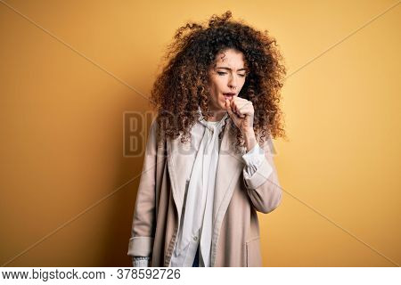 Young beautiful brunette woman with curly hair and piercing wearing casual t-shirt and diadem feeling unwell and coughing as symptom for cold or bronchitis. Health care concept.