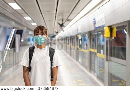 Asian Woman With Surgical Face Mask Feel Tired Use Smartphon Standing Waiting For Subway, Skytrain,