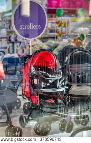 strollers in the display window in a shopping mall