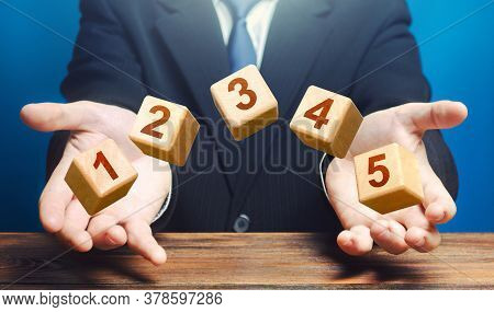 Man Throws 5 Numbered Blocks With The Numbers One Two Three Four Five From His Hands. Five Easy Step