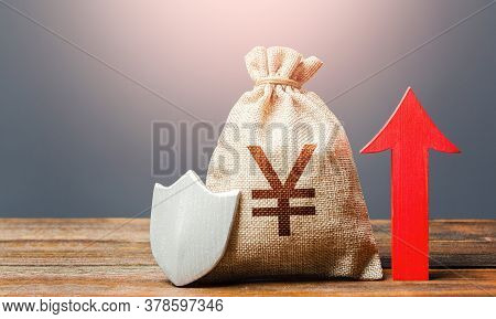 Yen Yuan Sterling Money Bag With A Shield And A Red Arrow Up. Safety Of Investments, Savings. Increa