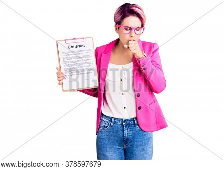 Young beautiful woman with pink hair holding clipboard with contract document feeling unwell and coughing as symptom for cold or bronchitis. health care concept.