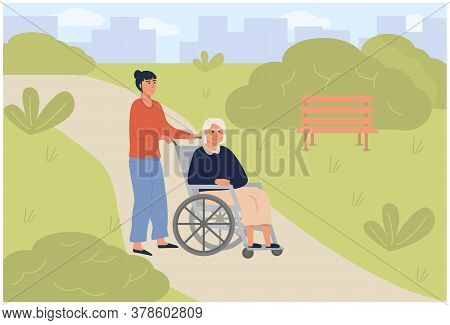 Young Daughter Social Worker Strolling With Old Woman On Wheelchair In Green Park. Elderly Senior Ag