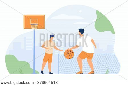 Sport Games Outdoors Concept. Two Athletic Young Men Playing Basketball In Urban Stadium. Guys Train