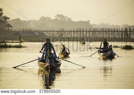 Mandalay/myanmar-october 6th 2019:  Tourists Are Riding A Gondola To Visit The U Bein Bridge, The Lo