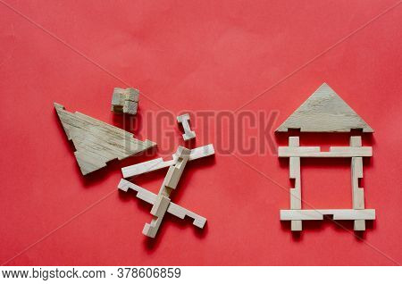 Wooden House From A Childrens Constructor And Details On Coral Background. Simple House With Wooden