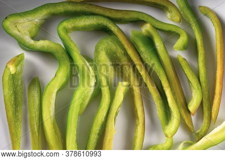Green Bell Pepper Slice Or Section Texture. Creative Pepper Pieces Layout. Set Of Sliced Vegetables