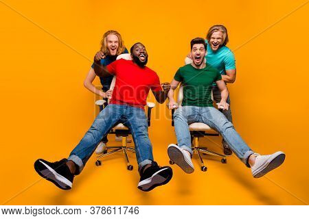 Full Length Photo Two Blonde Hair Men Have Office Chair Ride Challenge Afro American Guy Enjoy Fun P