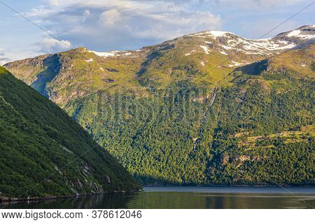 Impression From Cruise Ship On The Way Through Geiranger Fjord In Norway At Sunrise In Summer