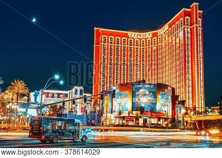 Main Street Of Las Vegas-is The Strip In Evening Time. Casino, Hotel And Resort- Treasure Island.