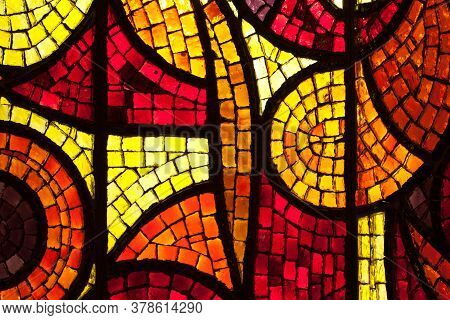 Glass Mosaic Layer In Yellow, Red And Orange Colors.