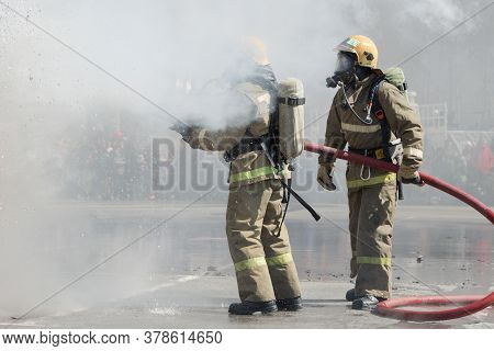Two Firefighters Extinguishes Fire From Fire Hose, Using Firefighting Water-foam Barrel With Air-mec
