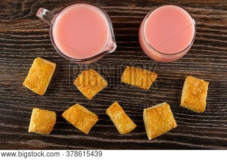 Few Small Puff Cookies, Milk Fruit Drink With Strawberry Juice In Transparent Glass And In Pitcher O