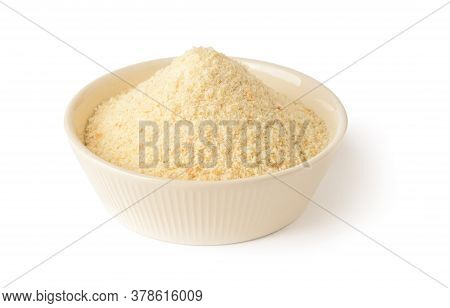 Wheat Bread Crumbs In A Beige Ceramic Bowl Isolated On White Background. Ingredient For Meatballs An