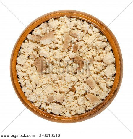 Smoked Tofu, Bean Curd, Crumbled By Hand, In A Wooden Bowl. Coagulated Soy Milk, A Component Of Asia