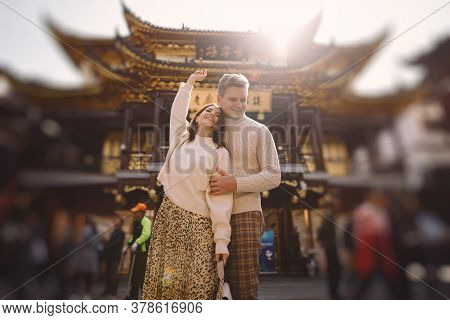 Newlywed Couple Showing Affection And Holding Hands In Shanghai Near Yuyuan While Visiting China