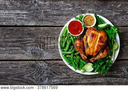 Whole Roast Chicken With Fried Pods Of Green Peas, Fresh Green Onion, Parsley, Lime, Tomato Sauce An