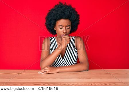 Young african american woman wearing casual clothes feeling unwell and coughing as symptom for cold or bronchitis. health care concept.