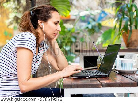 Woman Working On Laptop From Cafe Bar. Busy People Lifestyle.woman Typing On Laptop Computer In Bar.