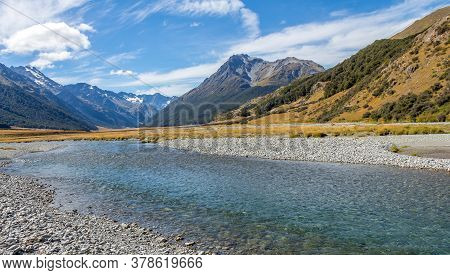 A Shallow, Fast Flowing River, In The Mountains Of New Zealand On A Sunny Day, Near Canterbury, Sout