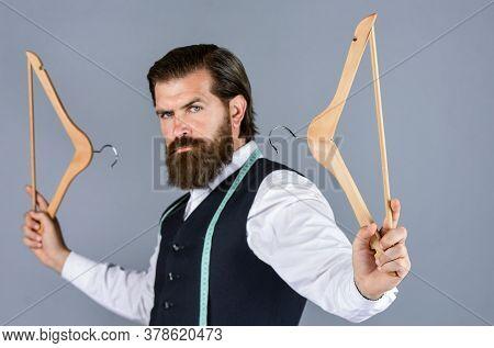 Fashion Model. Handsome Man In Smart Casual Wear Is Holding Hanger. Portrait Of Man Holding Hanger.