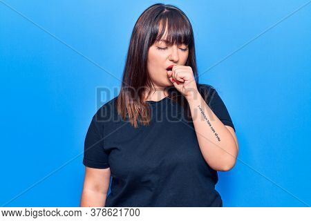 Young plus size woman wearing casual clothes feeling unwell and coughing as symptom for cold or bronchitis. health care concept.