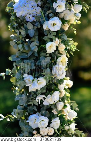 Outdoor Wedding Ceremony Setup, Wedding Arch Decorated With Pastel White Flowers