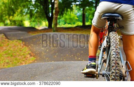 child on a bicycle- pump track outdoor
