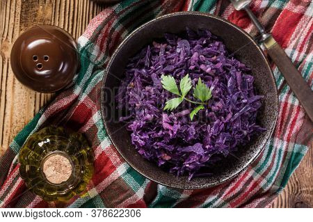 Salad Of Boiled Red Cabbage In A Dark Bowl.