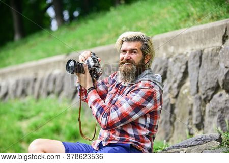 Content Creator. Man Bearded Hipster Photographer Hold Vintage Camera. Photographer Amateur Photogra