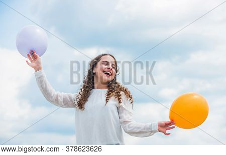 International Childrens Day. Happy Child With Colorful Air Balloons Over Blue Sky Background. Expres