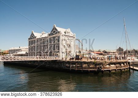 Cape Town, South Africa, February 17 2017: People Walking Over The Bridge By African Trading Port Bu