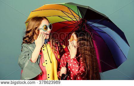 Cheerful Hipster Children, Sisterhood. Autumn Fashion. Happy Small Girls With Colorful Umbrella. Rai