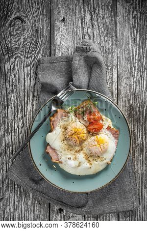 Fried Eggs With Pork Ham On Wooden Table. Top View.