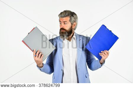 Man In Formal Suit Holding Clipboard Looking Information. Businessman With Document. Inspecting. Con