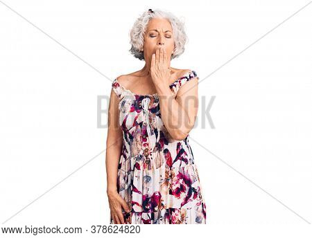 Senior grey-haired woman wearing casual clothes bored yawning tired covering mouth with hand. restless and sleepiness.
