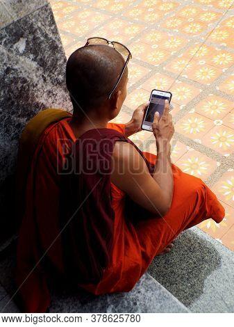 Chiang Mai, Thailand, May 25, 2017: Buddhist Monk Checks His Phone In Chiang Mai, Thailand.