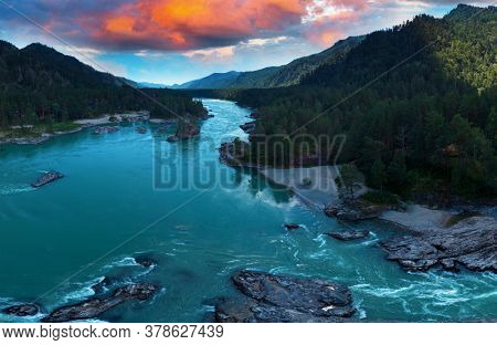 Aerial view of Katun river, in summer morning in Altai mountains with beauty sunset sky, drone shot