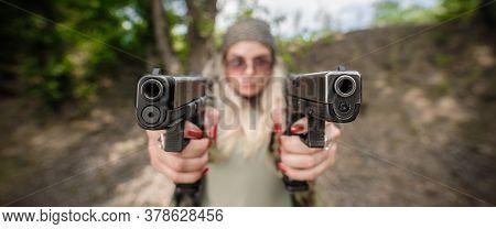 Soldier Woman With Two Gun. Gun Point Aim To Attacker