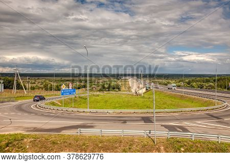 Summer Day Landscape. The Highway Goes Away With A Bridge Over The Ugra River On A Sunny Summer Day.